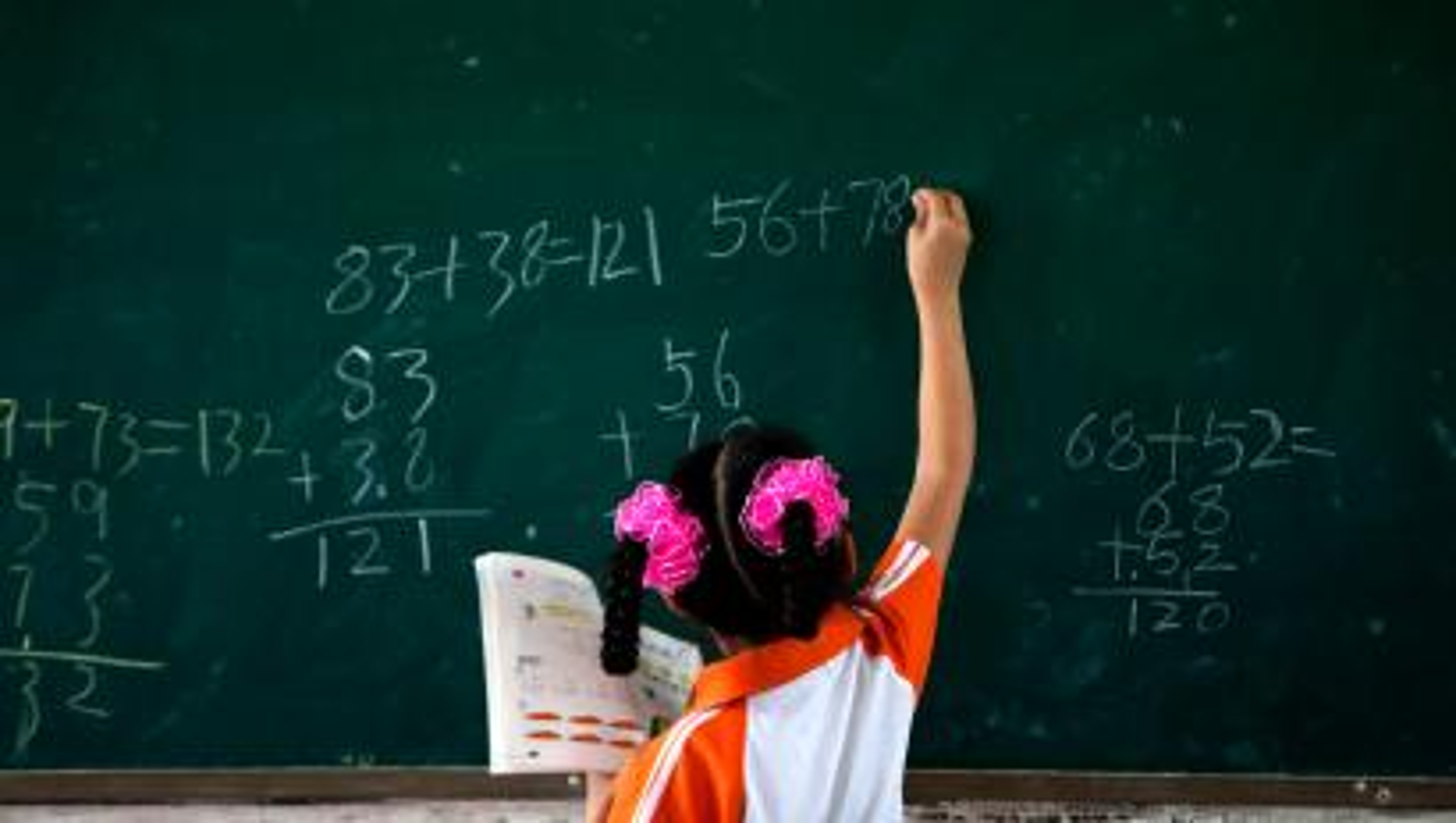 girl at blackboard doing math