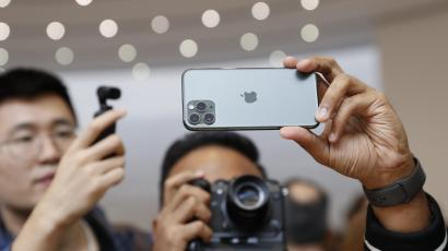People take photos of the new iPhone 11 Pro in the demonstration room at an Apple event at their headquarters in Cupertino, California, U.S. September 10, 2019.