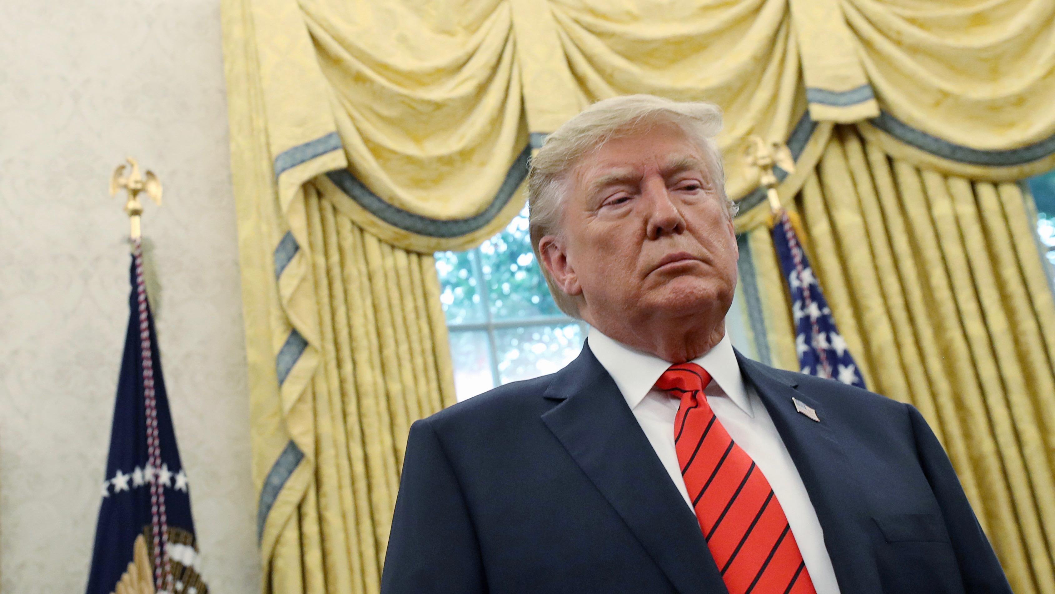 A gloomy looking Trump.