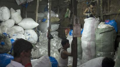 Inside a recycling factory in India, workers Sort through plastic waste