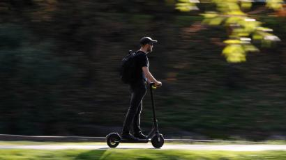 A man riding an electric scooter