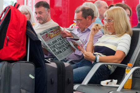 British passengers wait for news on cancelled Thomas Cook flights at Palma de Mallorca airport on Sept. 23
