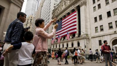 Chinese tourist visiting Wall Street in New York City.