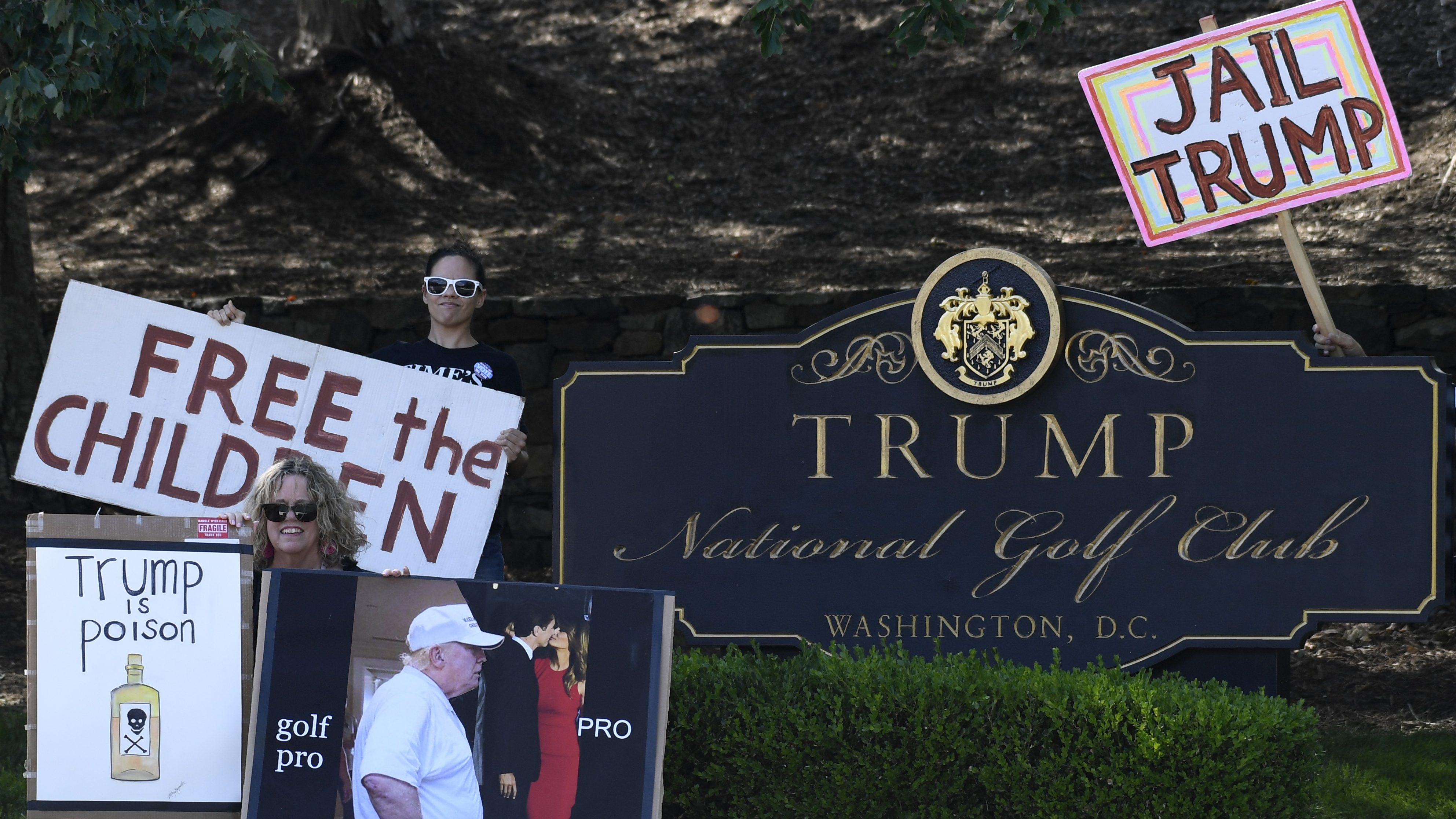 Protesters outside the Trump National Golf Club in Sterling, Virginia, where the gala dinner will be held.