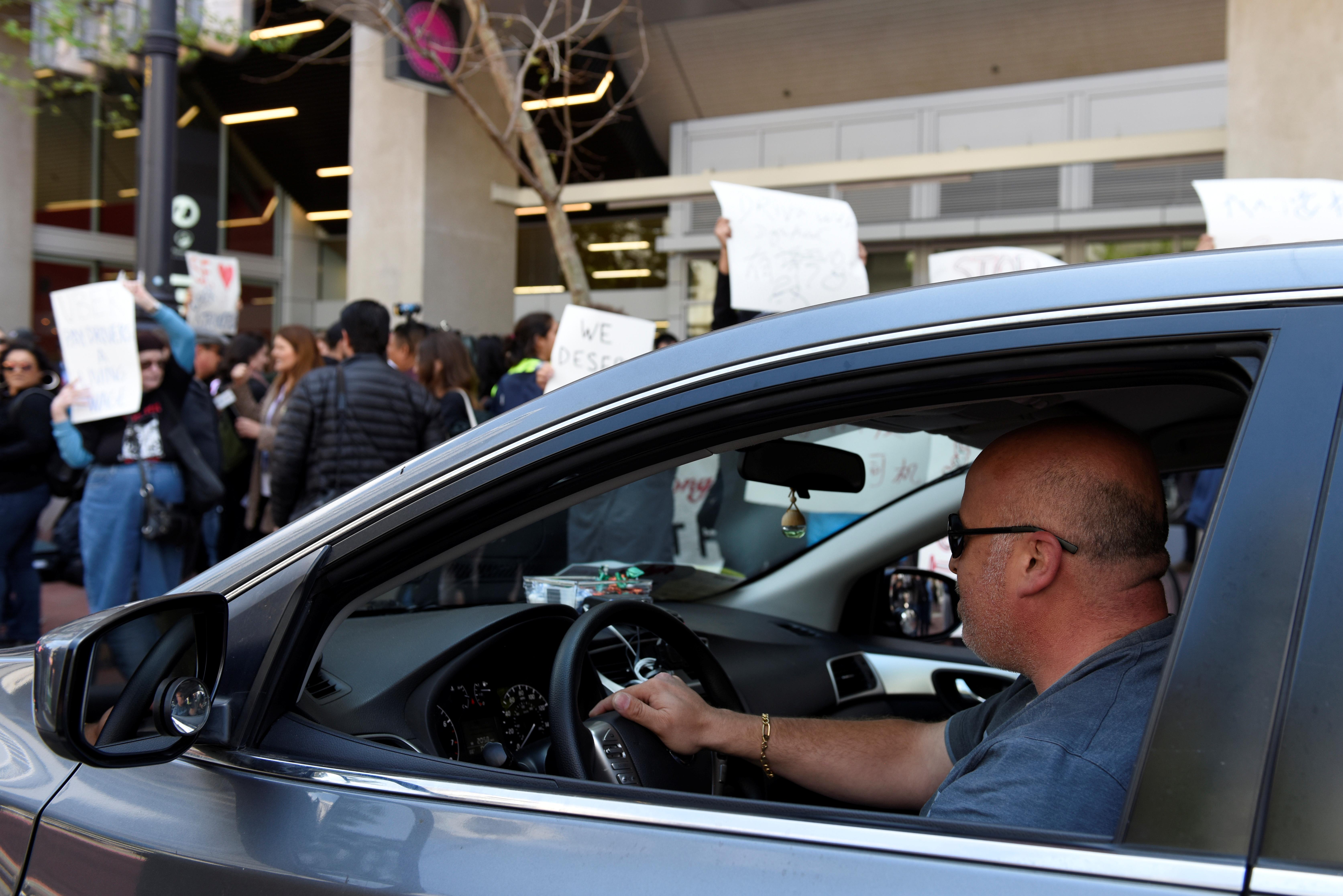 Uber drivers honk in solidarity.