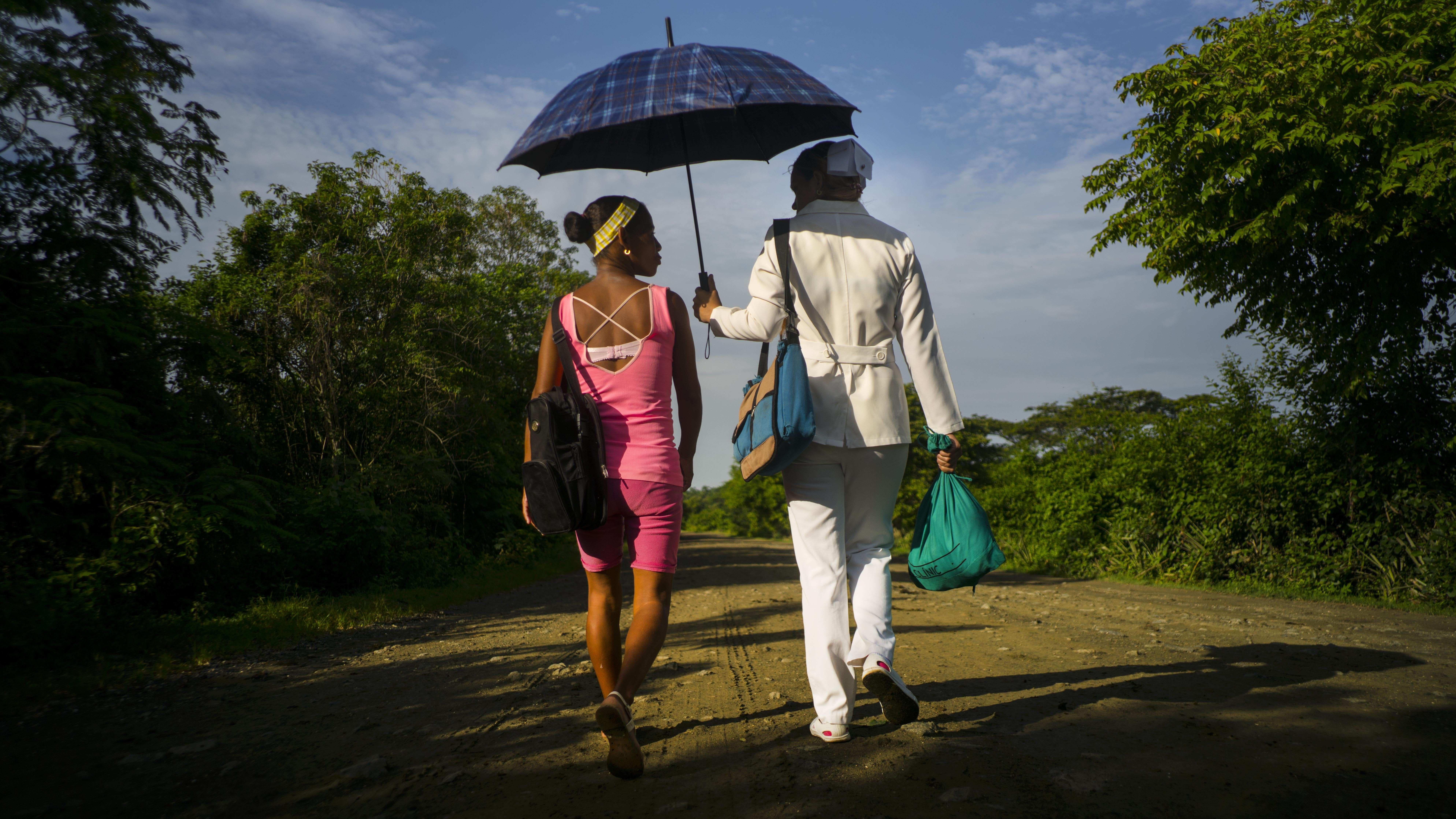 couple walking under an umbrella
