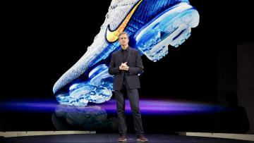 Mark Parker stands in front of a screen featuring Nike sneakers