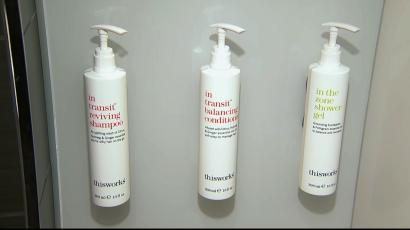 Image of wall-mounted shampoo and conditioner bottles