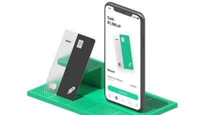 Robinhood's Mastercard debit card and a phone displaying its cash management feature