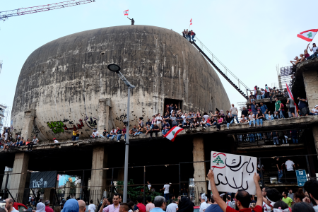 "Protesters gather inside and atop Beirut's famous ""The Egg"" in downtown Beirut."