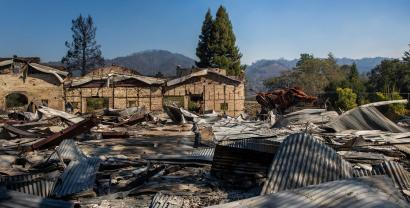 """""""Lord Snort"""", a steel sculpture of a boar, one of the only structures to survive, is seen among the rubble after the Soda Rock Winery."""