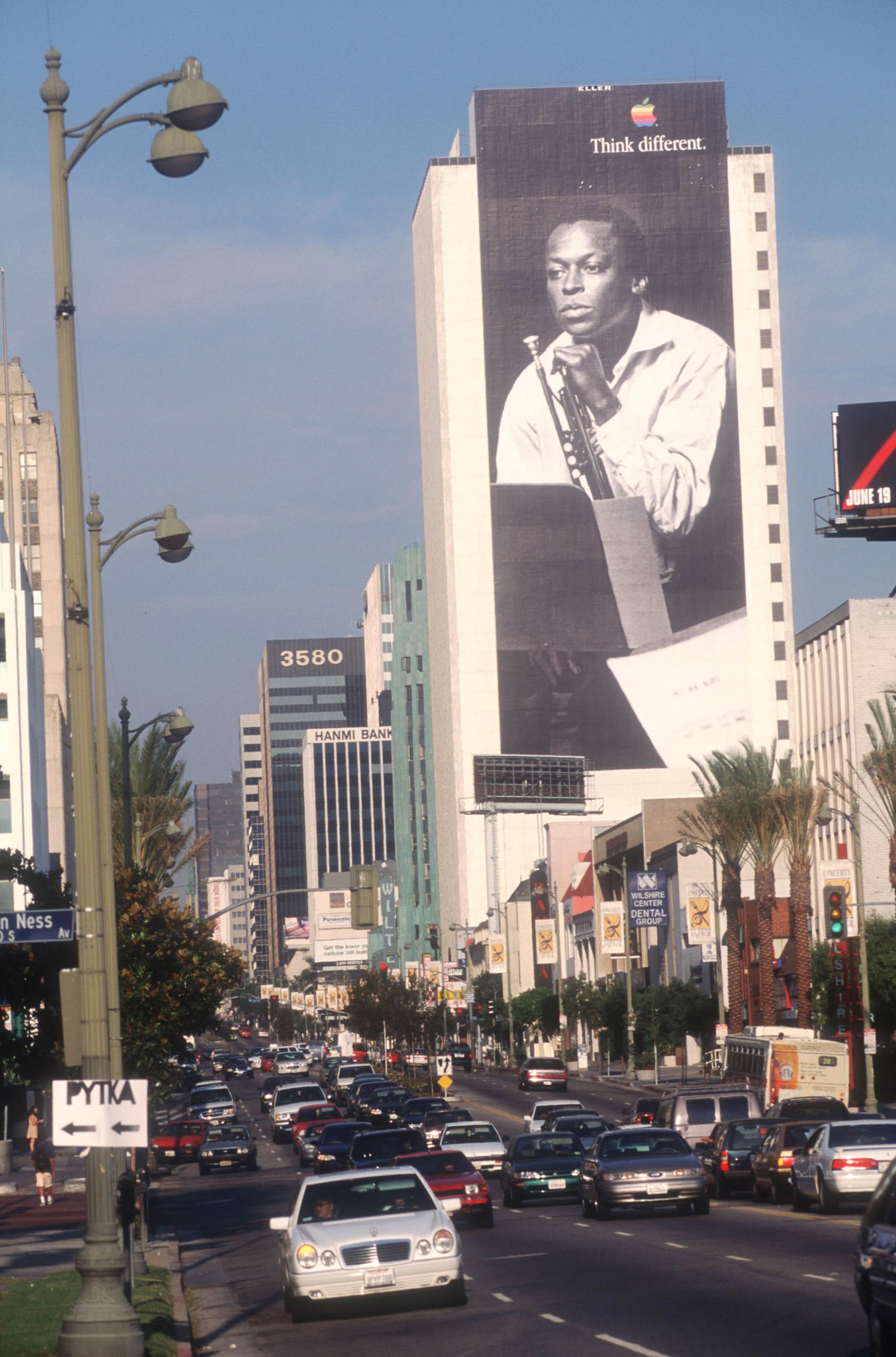 A billboard depicting Miles Davis promotes Apple Computers