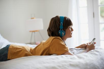 young person listening to music
