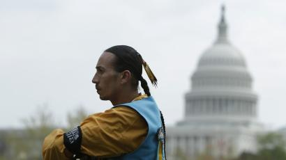Native American man in front of US capitol building