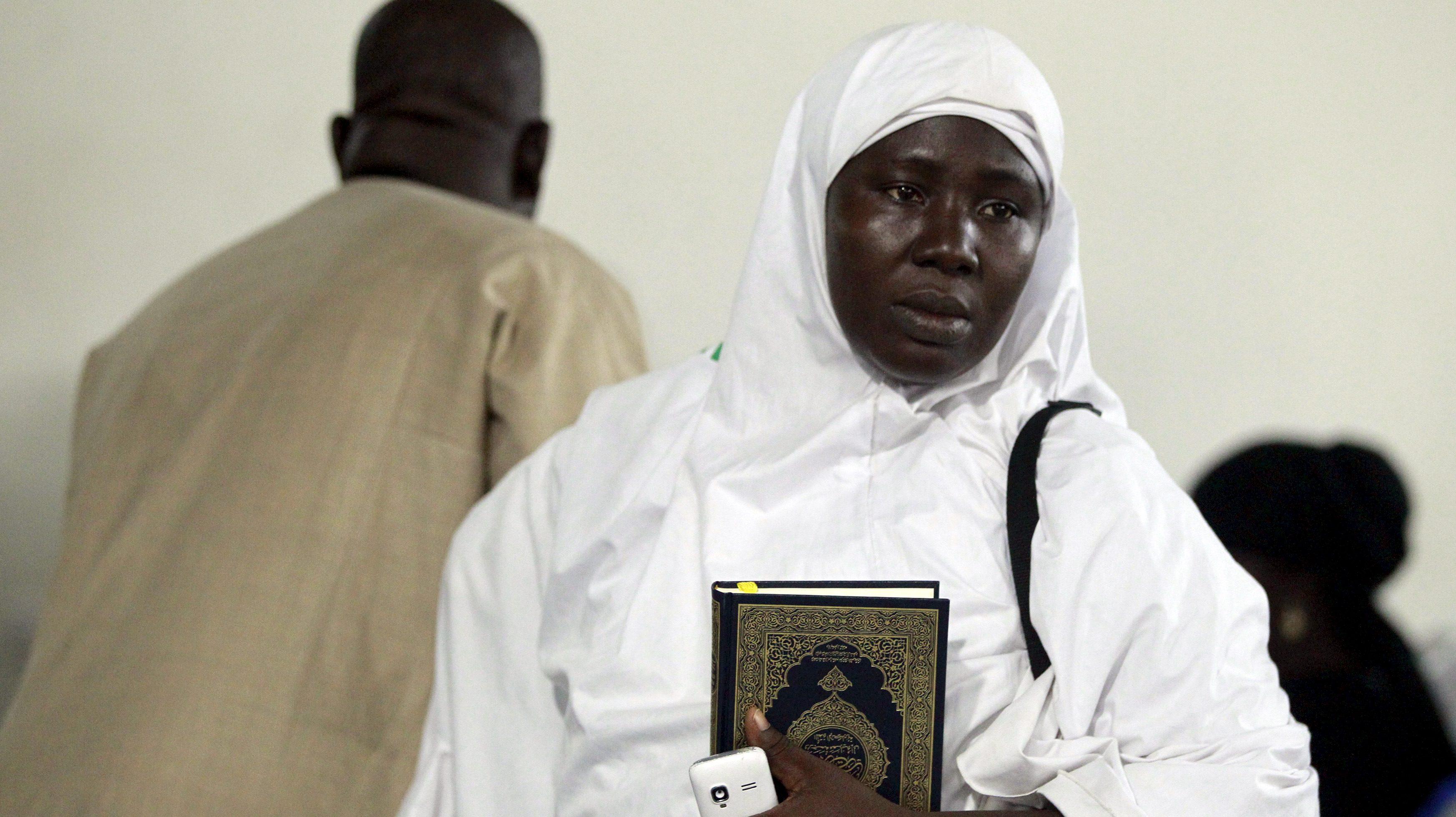 A female pilgrim returns from the hajj