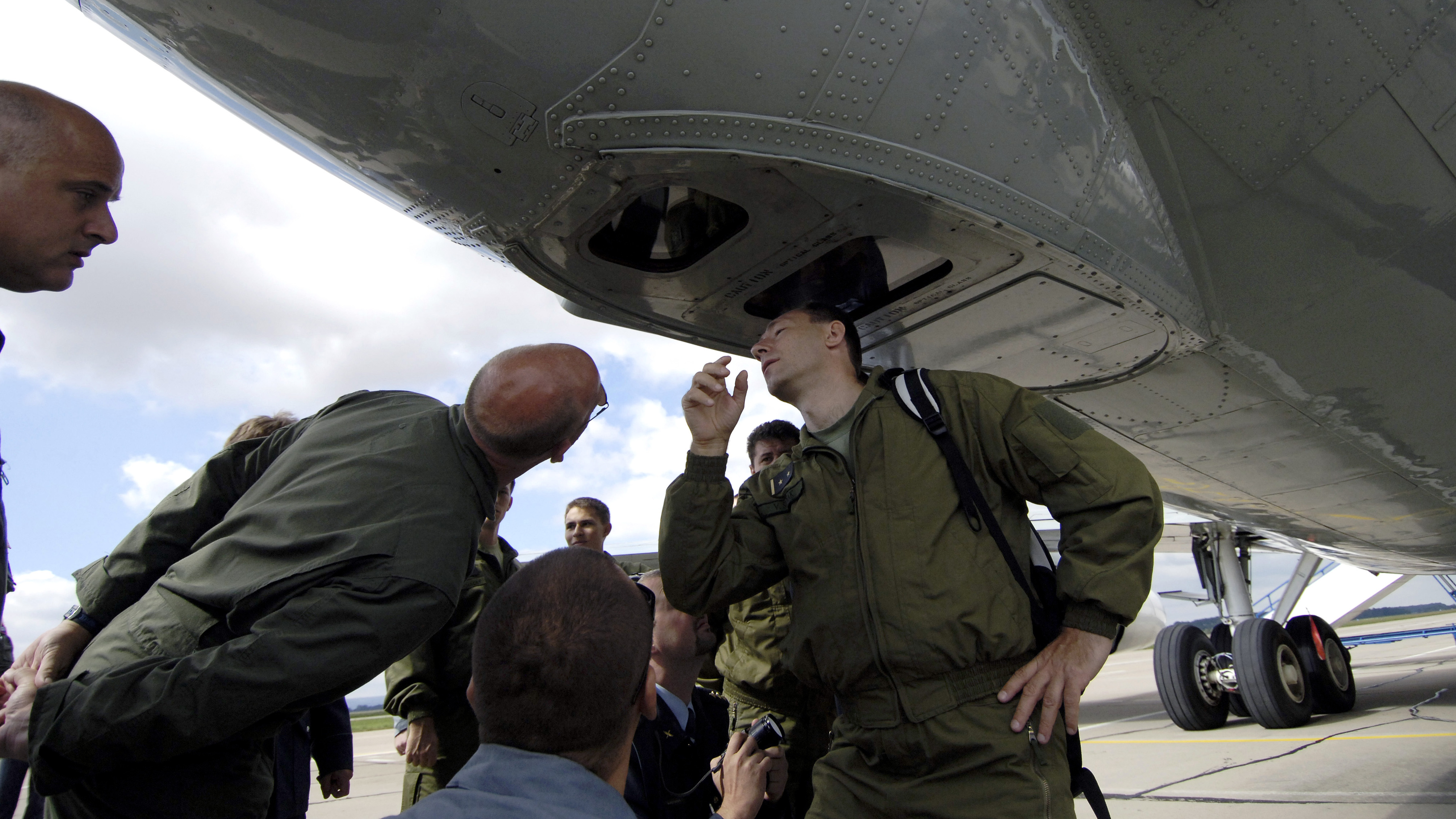 Czech soldiers inspect cameras installed on a U.S. observation aircraft in 2007.