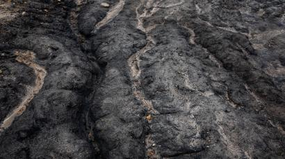 Paths traced by water on the surface of a coal mine.
