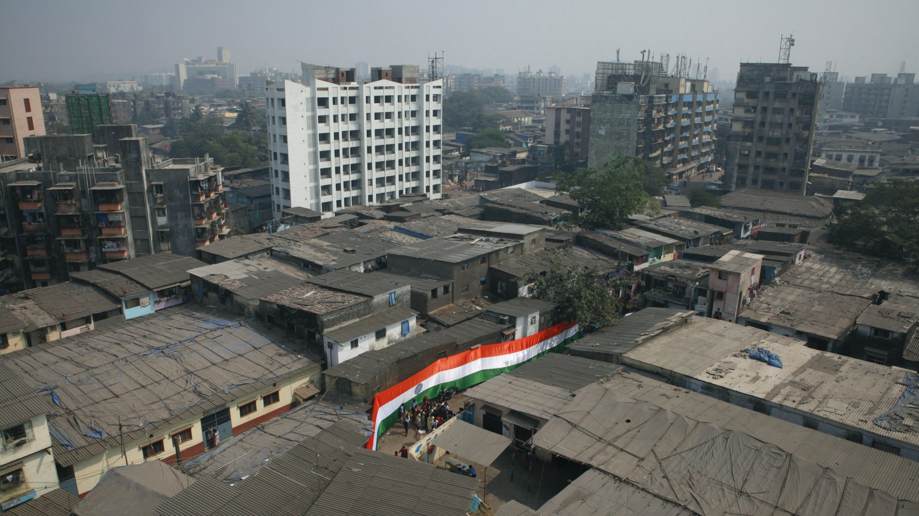 A Indian national flag is pictured in a street in Dharavi one of Asia's largest slums in Mumbai