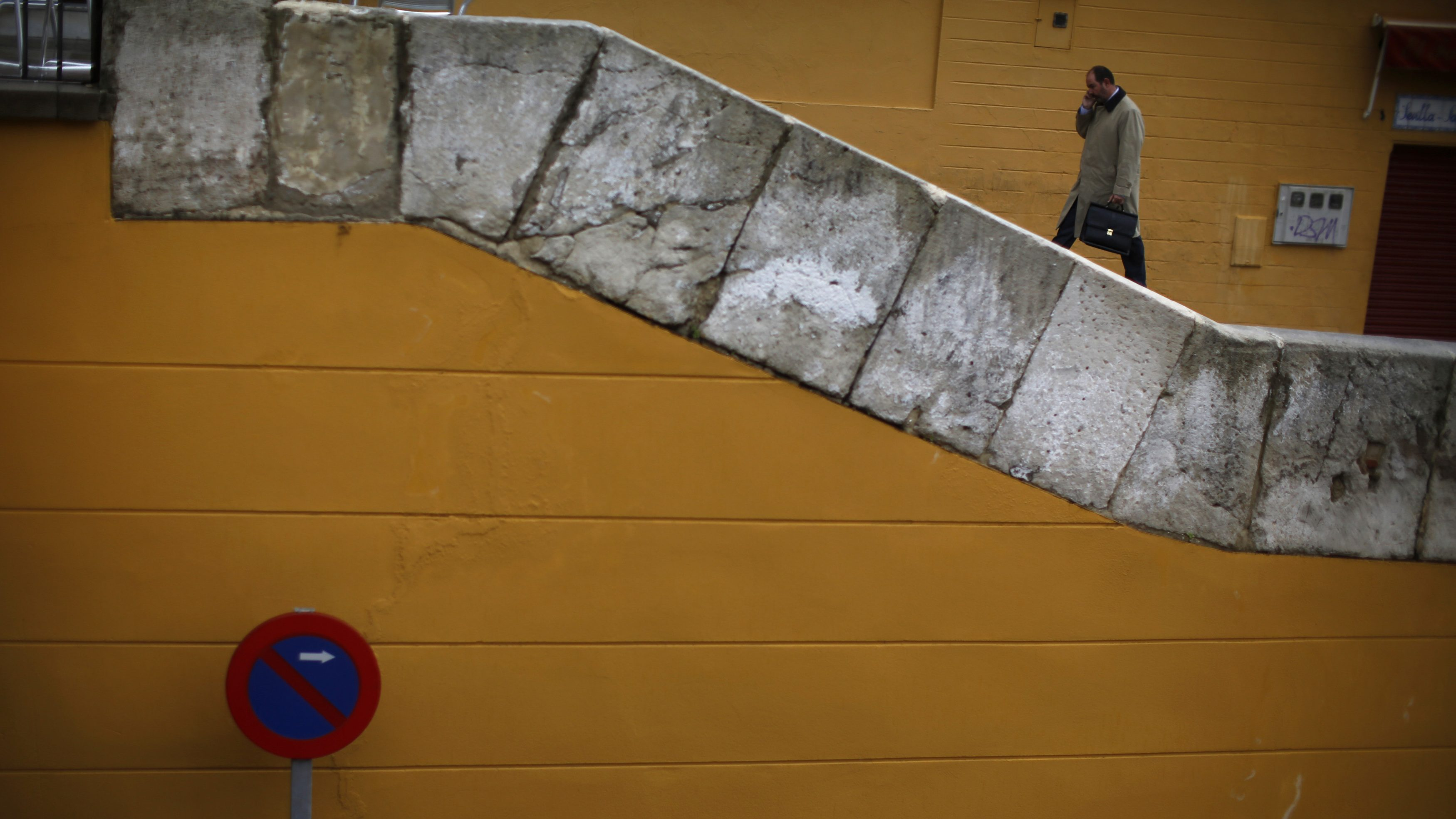 A man climbs up stairs in the Triana city quarter of the Andalusian capital of Seville