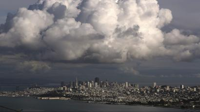 A large cloud gathers over the skyline of San Francisco