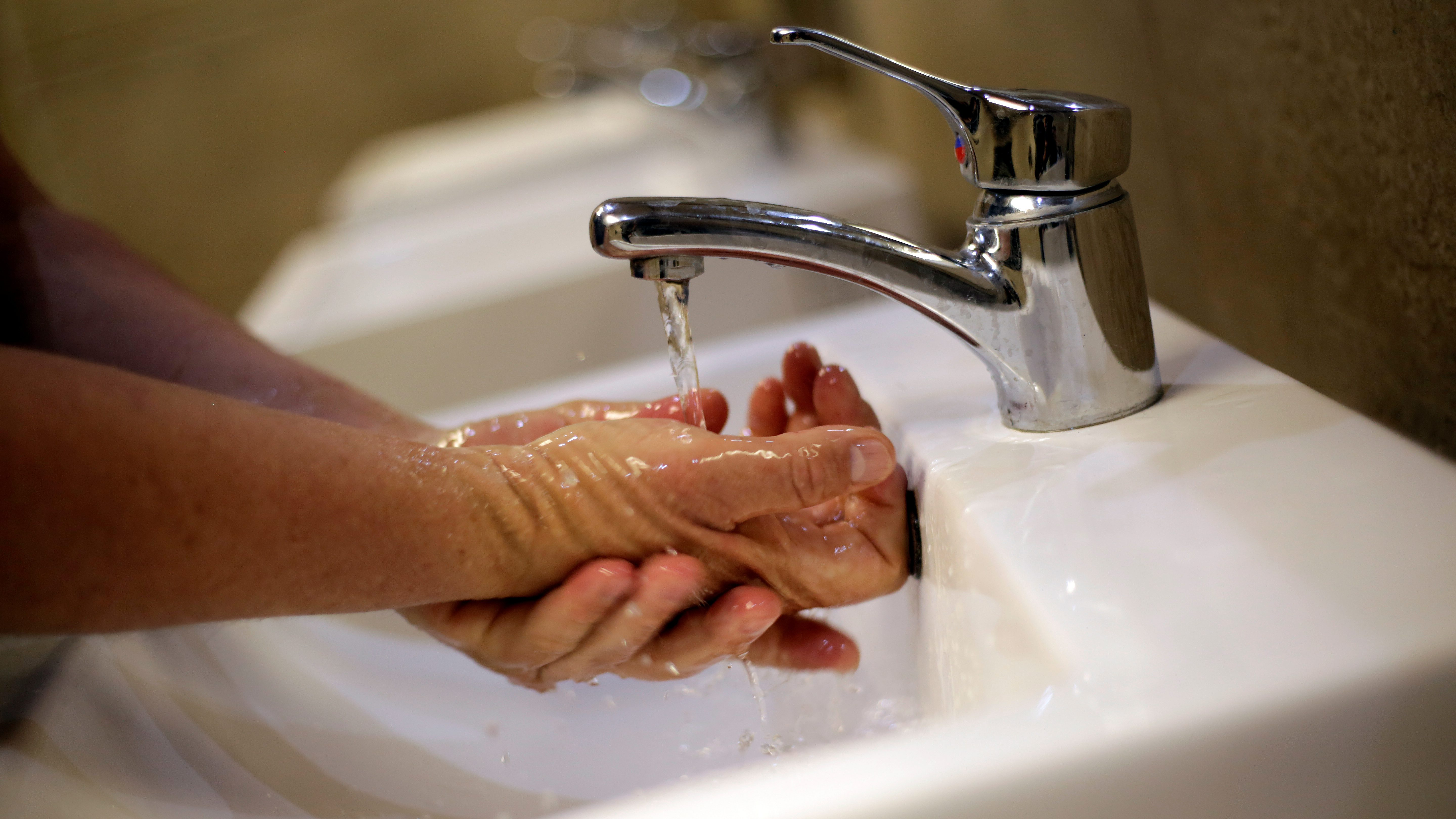 A man washes his hands at a shopping mall in Ciudad Juarez