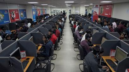 Employees of a private call centre hired by India's main opposition Congress party make calls to party workers in Jaipur