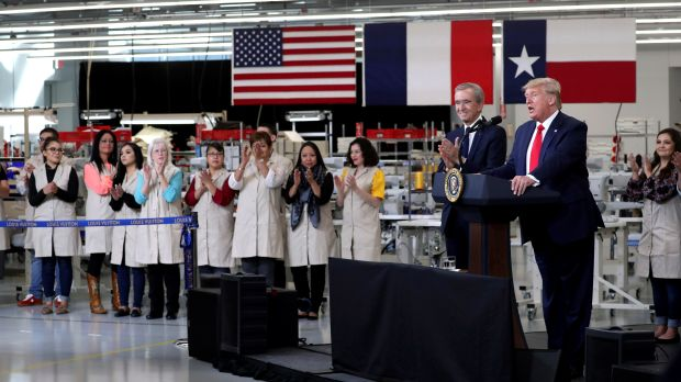 U.S. President Donald Trump speaks next to Louis Vuitton's Chairman and CEO of Luxury goods group LVMH Bernard Arnault during his visit to the Louis Vuitton Rochambeau Ranch leather workshop in Texas.