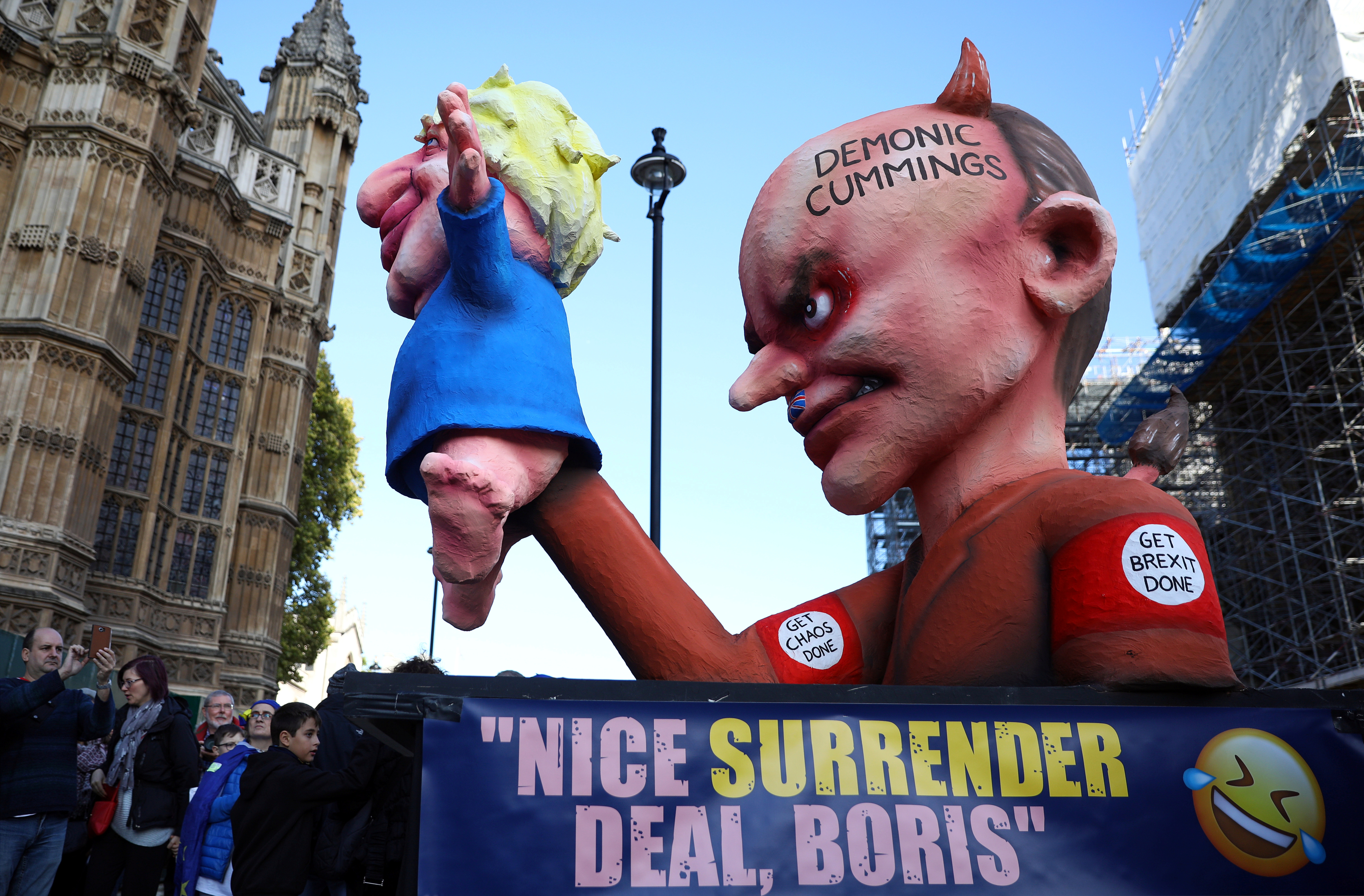 Figures depicting Britain's Prime Minister Boris Johnson and his special advisor Dominic Cummings are displayed during a demonstration as parliament sits on a Saturday for the first time since the 1982 Falklands War, to discuss Brexit in London, Britain, October 19, 2019.