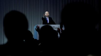 FILE PHOTO: Journalists raise their hands to ask questions to Japan's SoftBank Group Corp Chief Executive Masayoshi Son during a news conference in Tokyo