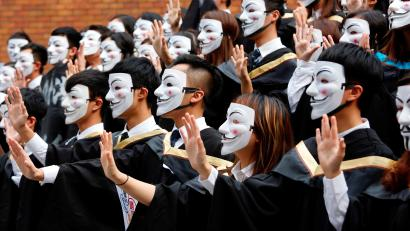 University students wearing Guy Fawkes masks pose for a photoshoot of a graduation ceremony to support anti-government protests at the Hong Kong Polytechnic University, in Hong Kong, China October 30, 2019.