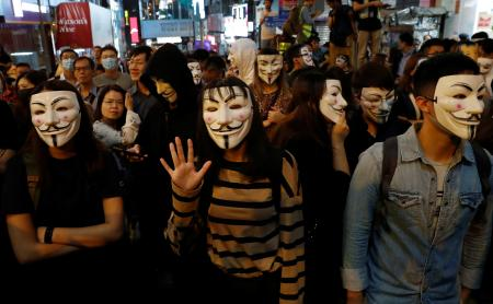 Anti-government protesters wearing costumes march during Halloween in Lan Kwai Fong, in Hong Kongss Central district on Oct. 31.