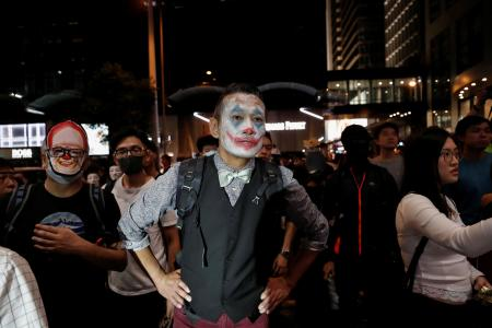 A protester in Joker makeup takes part in a Halloween march in Hong Kong on Oct. 31.