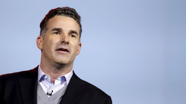 Kevin Plank in a jacket, sweater, and button-up shirt