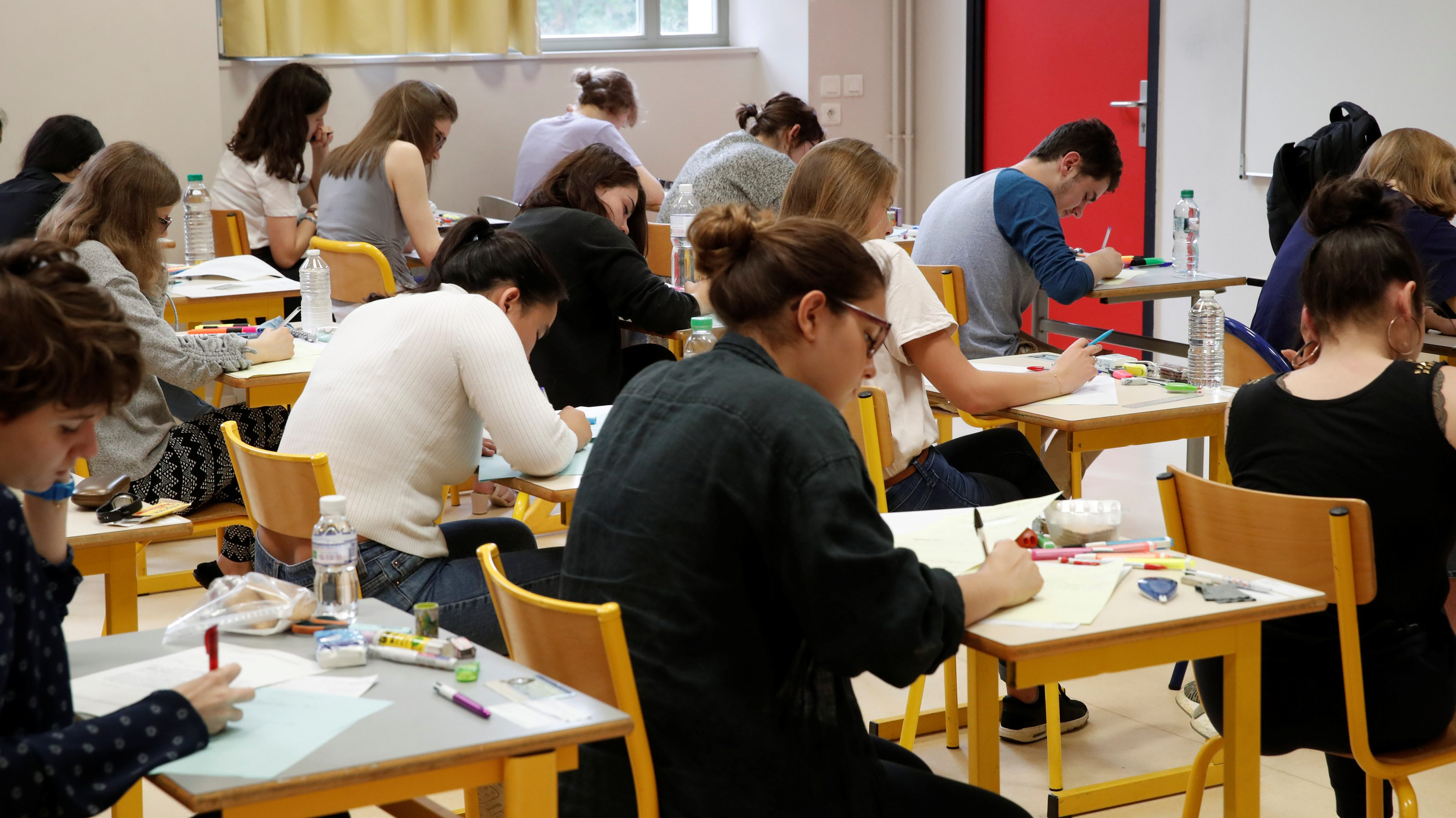 High school students start working on a 4 hours philosophy dissertation, that kicks off the French general baccalaureat exam at the lycee La Bruyere in Versailles