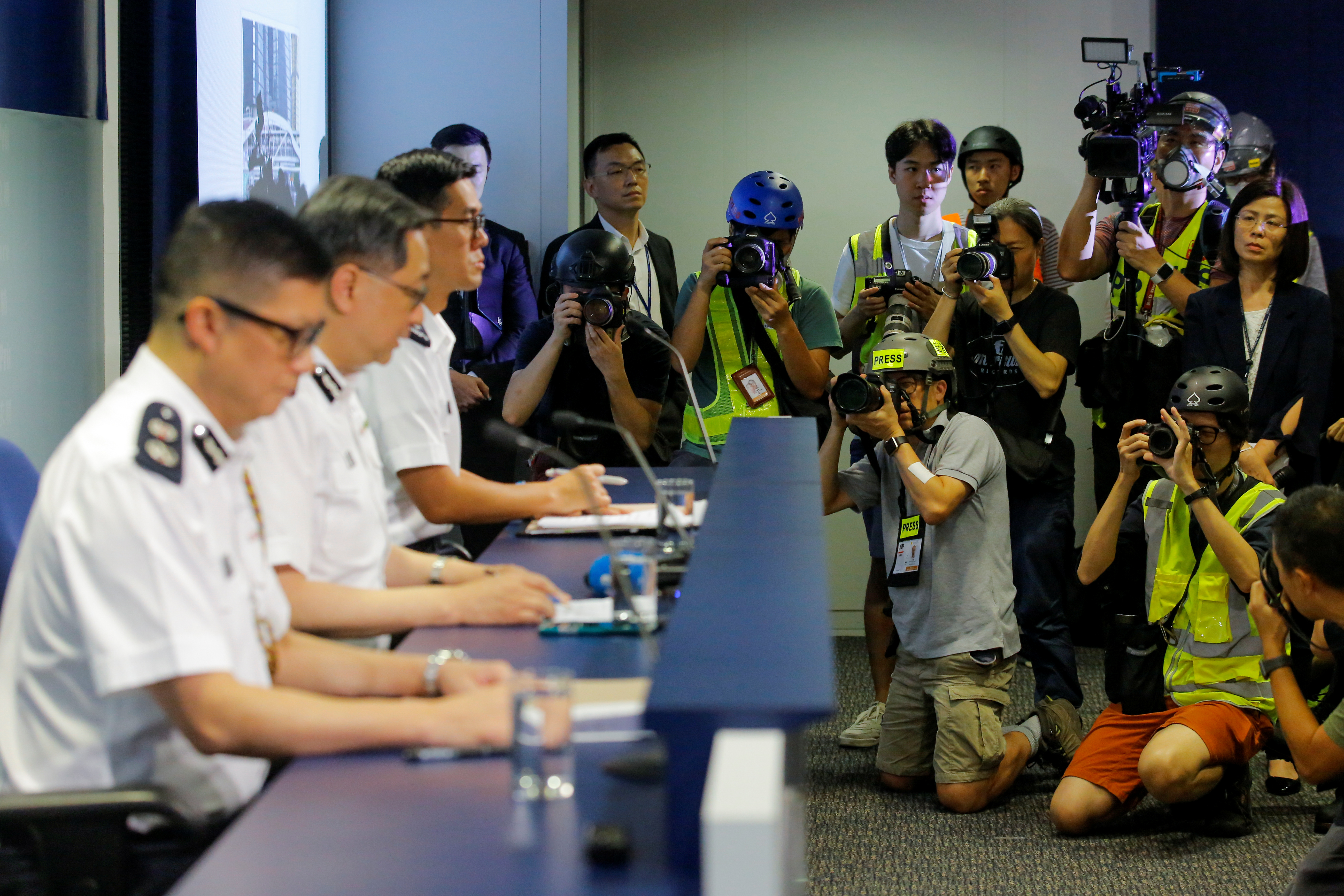 Hong Kong journalists took over a police news conference in protest