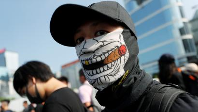 A masked anti-government protester attends a demonstration in Hong Kong, China, September 15, 2019.