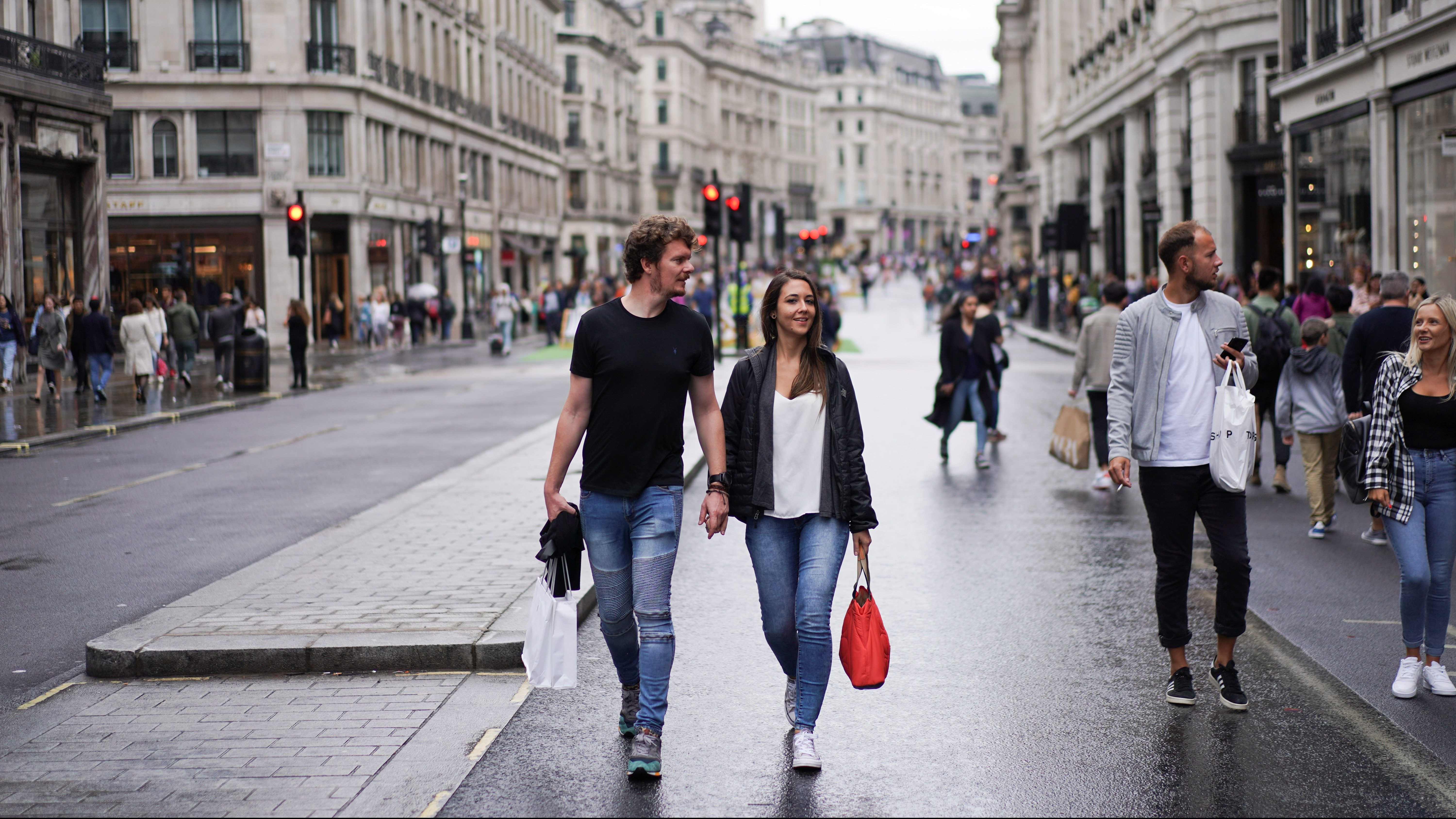 People walk down Regent Street after it was shut as part of 'Car Free Day' in London