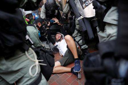 Riot police detain an anti-government protester during a demonstration at Wan Chai district, on China's National Day in Hong Kong, China October 1, 2019.
