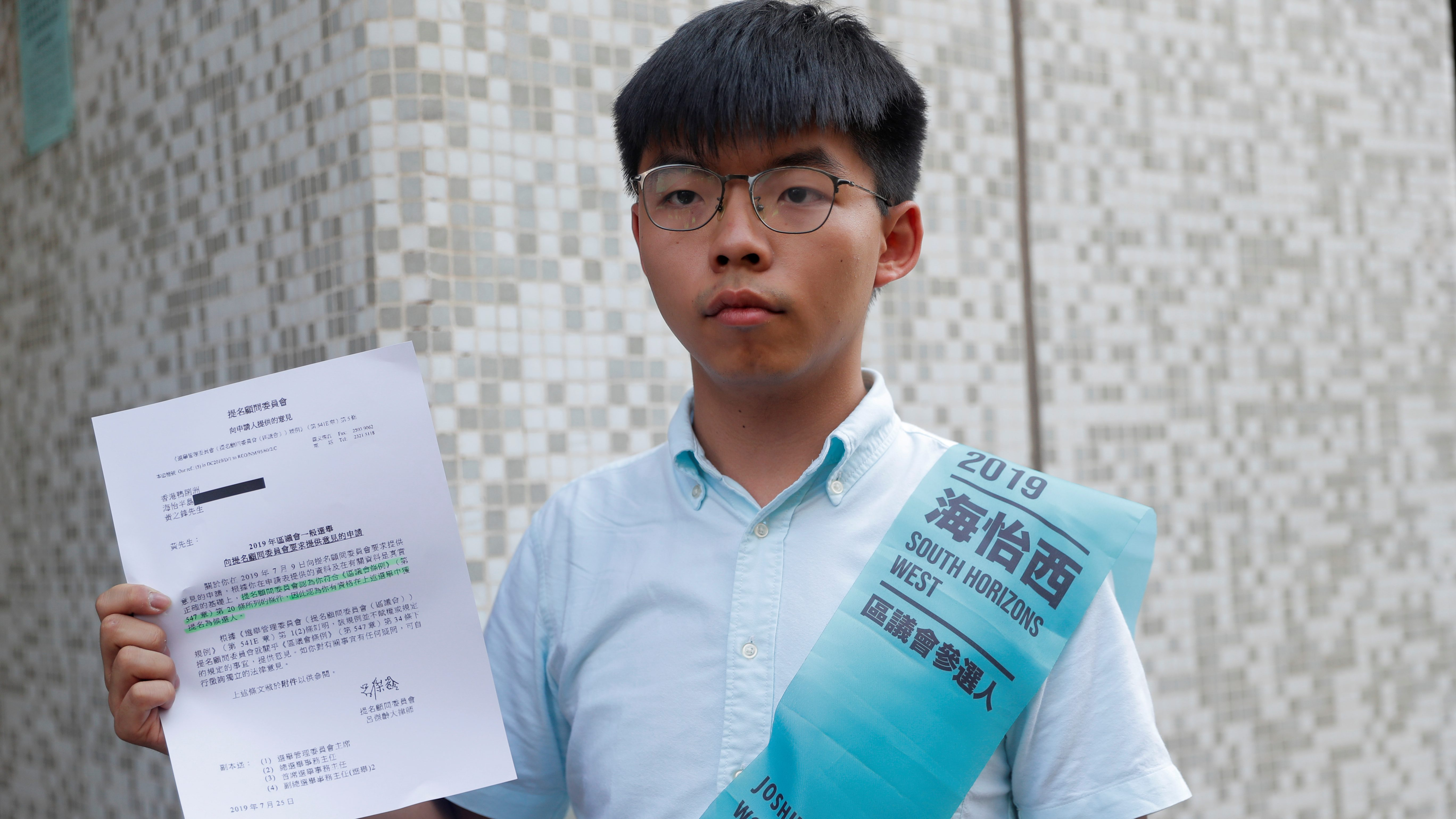Joshua Wong, secretary-general of Hong Kong's pro-democracy Demosisto party, poses before submitting his application for the race in the 2019 District Council Election, at the Southern District Office in Hong Kong, China, October 4, 2019.