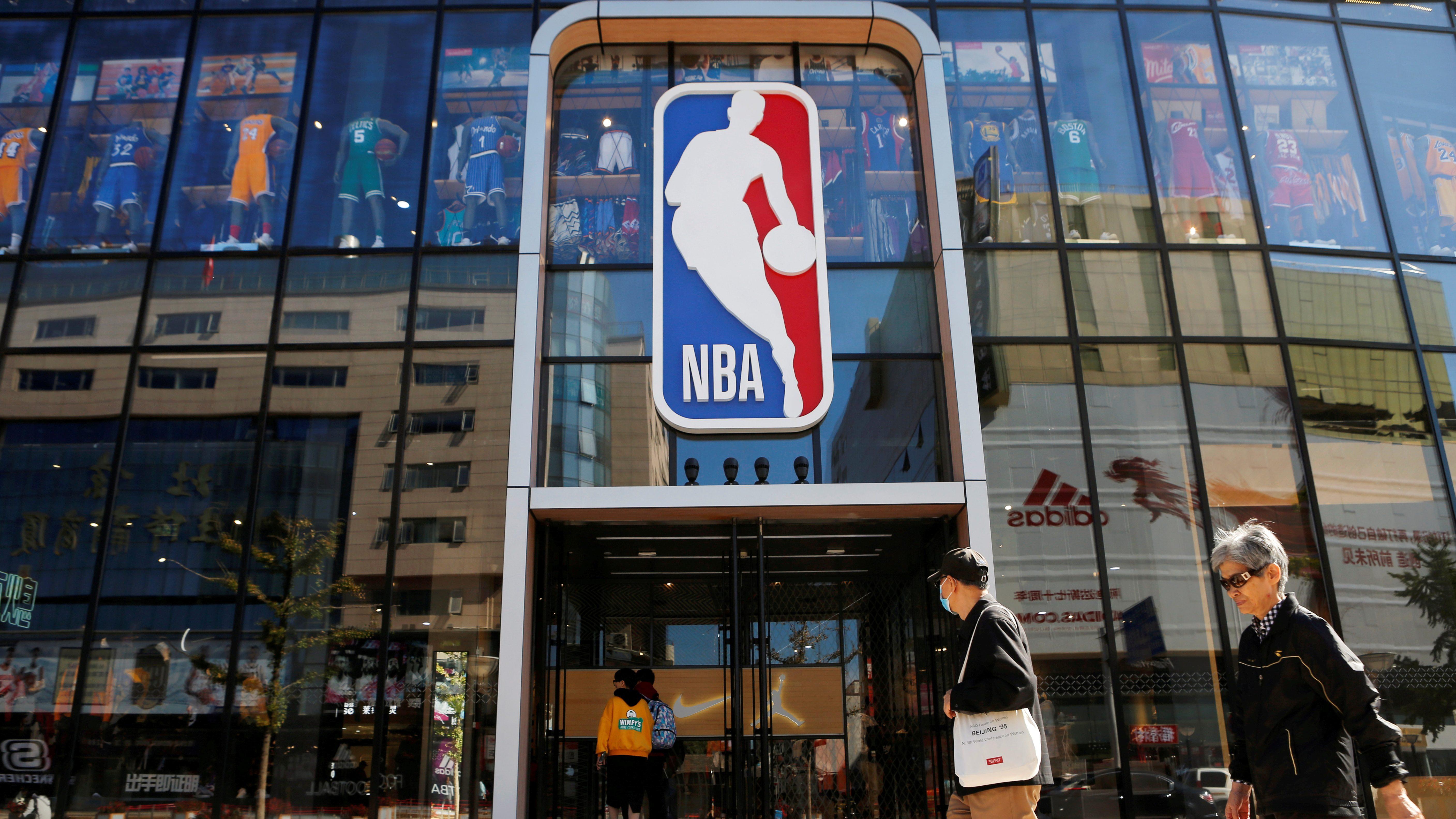 People enter a flagship NBA store at the Wangfujing shopping street in Beijing, China