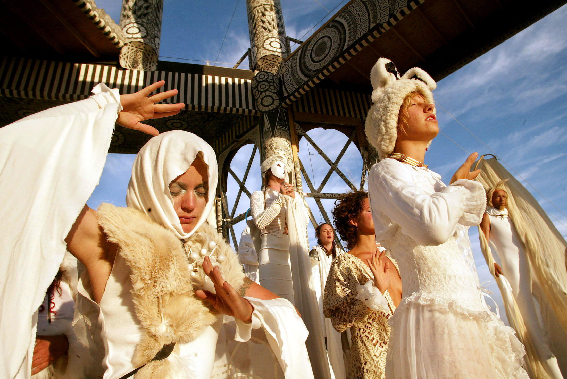 Members of the Naobi Village perform an early morning ritual at the Burning Man Festival in Black Ro..