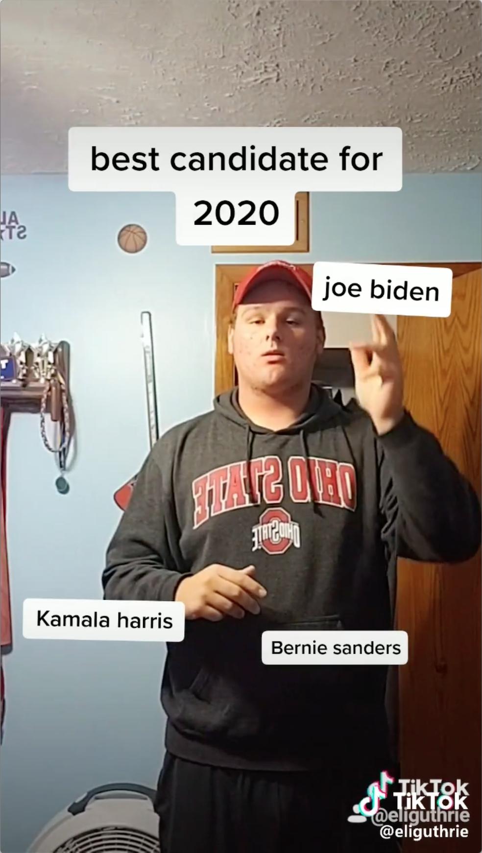 Still from a video showing man using a finger gun to shoot name of presidential candidate Joe Biden