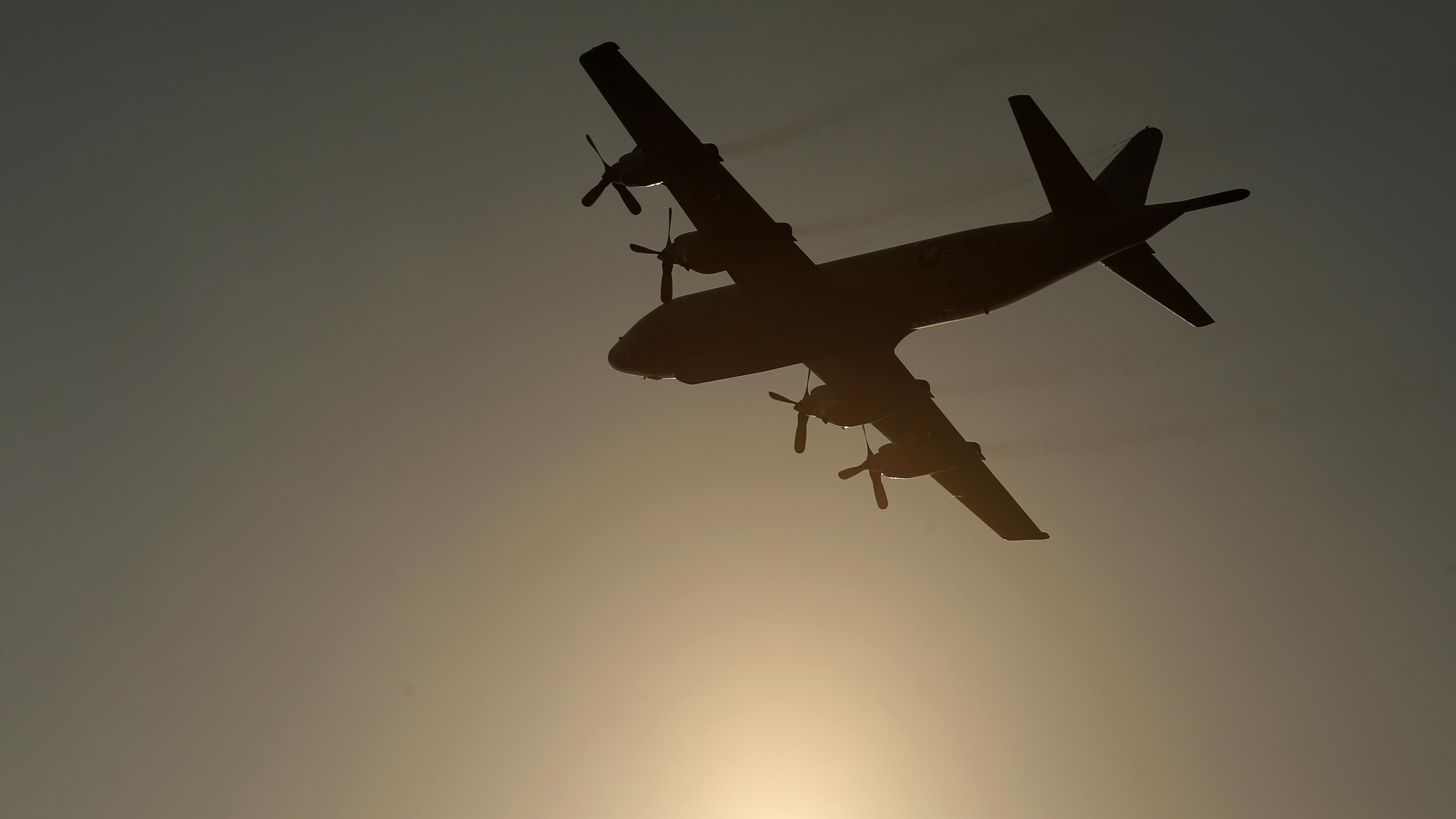 A US Navy aircraft flies over Incirlik airbase.