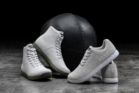 Nobull sneakers posed in front of a medicine ball