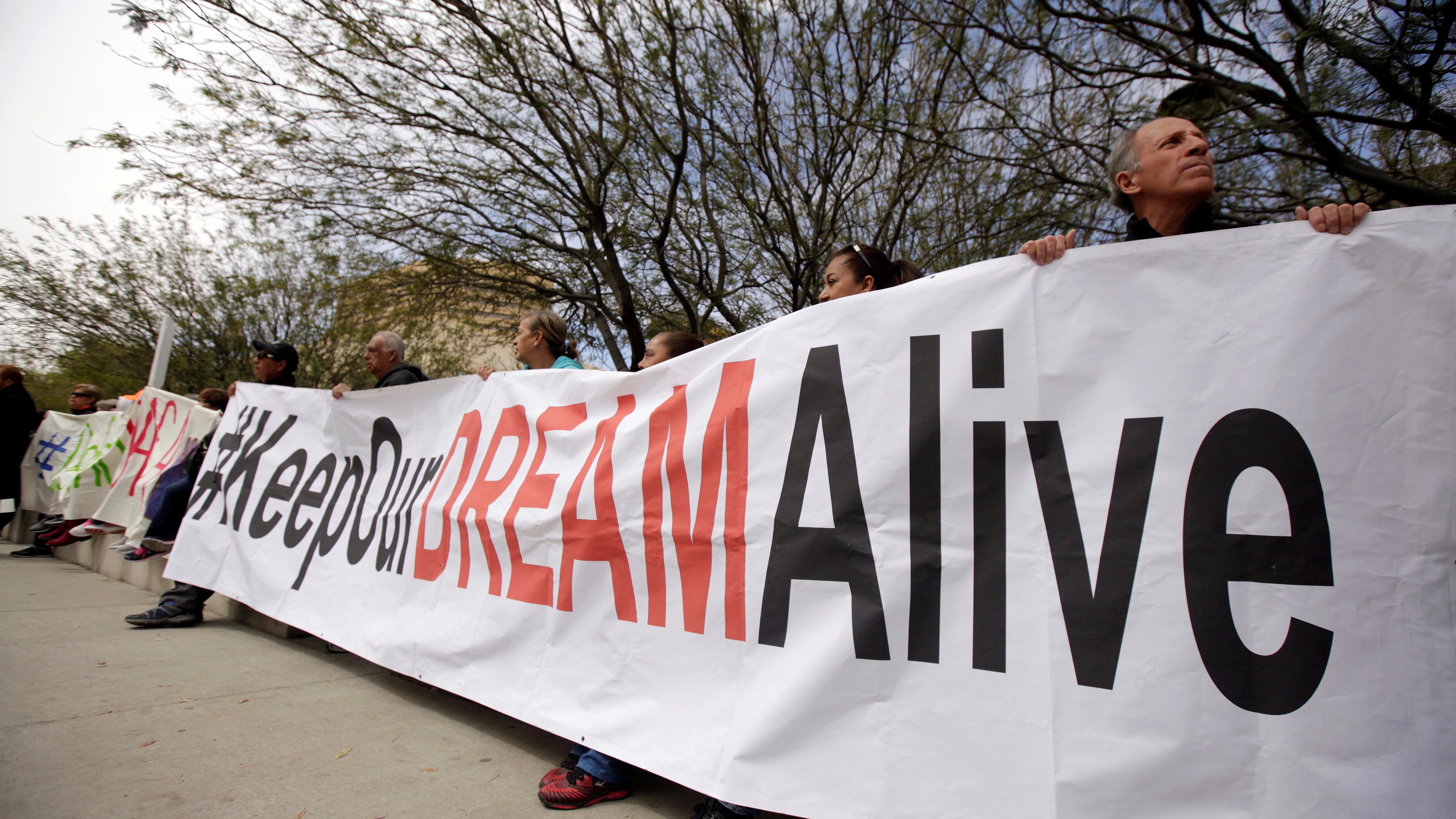 Members of the Border Network for Human Rights and Borders Dreamers and Youth Alliance (BDYA) hold a banner during protest outside a U.S. Federal Courthouse to demand that Congress pass a Clean Dream Act in El Paso, Texas, U.S. March 5, 2018.