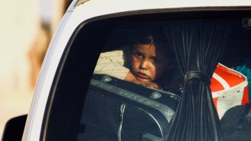 Child in car fleeing Operation Peace Spring.