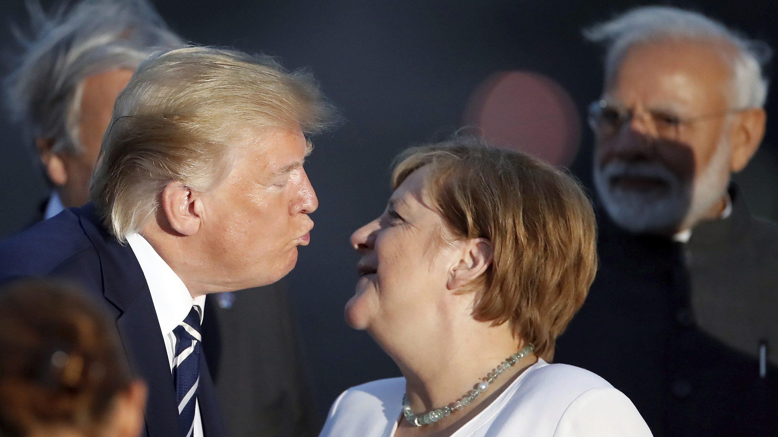Trump kissing Angela Merkel