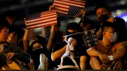 Anti-government demonstrator holds U.S. flags in Hong Kong.