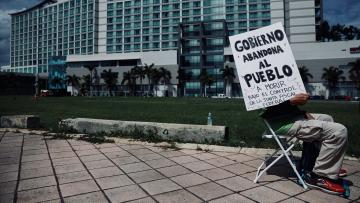 A Puerto Rican protests near the convention center when the Financial Oversight and Management board met last year.