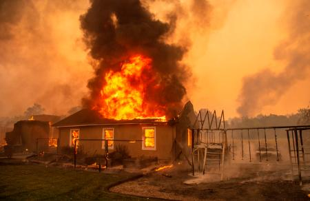 A home burns at a vineyard during the Kincade fire near Geyserville, California on Oct. 24.